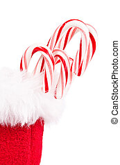 Candy canes in red Christmas gift bag on white background