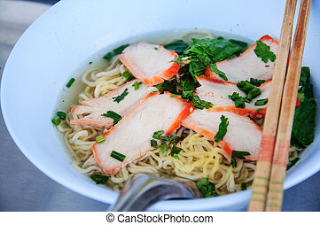 Egg chinese dry noodles with roast red pork, dumpling and vegetables