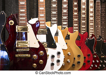 Electric Guitars - A row of electric Guitar on display