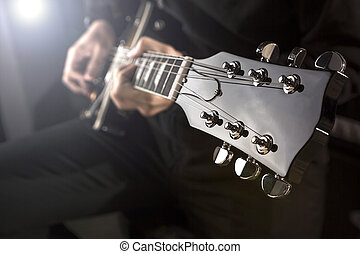 Playing guitar - Close up of a man playing a guitar with...