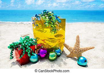 Starfish with gifts and christmas balls on the beach