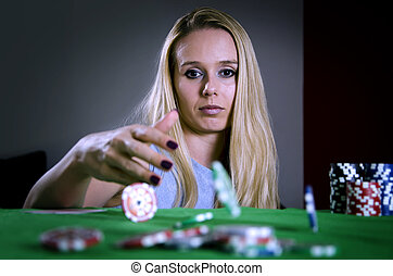 woman throwing poker chips on the table betting
