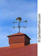 Kiwi bird weather vane on a rooftop Cromwell, Otago New...