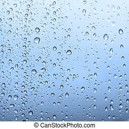 Waterdrops on a glass surface. Selective focus this image