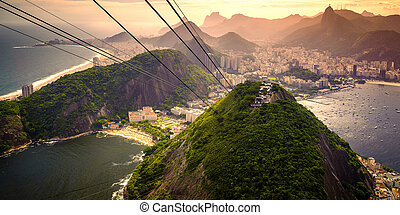 Urca - Cable car approaching Sugarloaf Mountain, Urca, Rio...