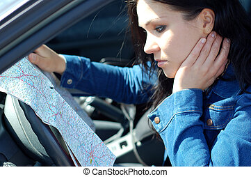 woman with map - attractive brunette woman in car