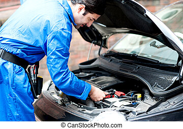 Mechanic repairing cars engine - Skilled car mechanic...