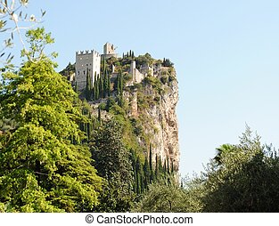 castle of arco - fortress atop the mountain in the town of...