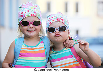 Two little identical twins in sunglasses - Two little...