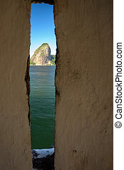 Sugarloaf Mountain viewed through a hole of wall, Guanabara...