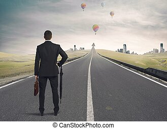 The road to success - Businessman looking the road to...