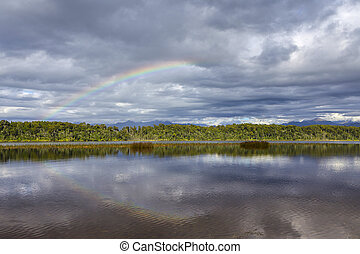 Rainbow at Lake Mahinapua in New Zealand