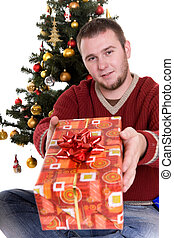 christmas - happy man with gifts over christmas tree