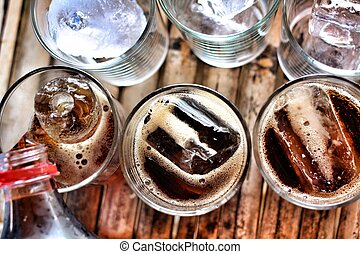 Pouring a glass of cola with ice