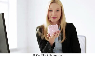 business woman with piggy bank and money - attractive...