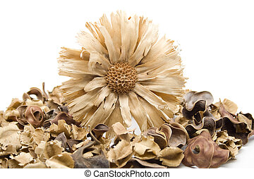 Straw flower with potpourri on white background