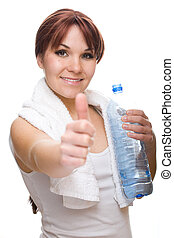 thirsty woman - attractive thirsty woman with bottle of...