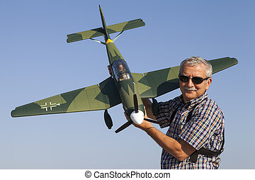 Senior RC modeller and his airplane - Friendly senior RC...