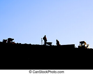 workers in the morning - Silhouette of workers on a ridge...