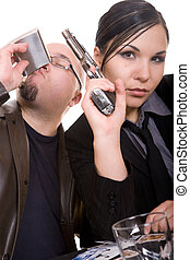 mafia - man and woman with gun over white background