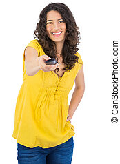 Cheerful curly haired pretty woman on white background...
