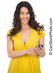 Smiling casual young woman sending text message - Smiling...