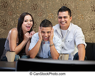 Family Laughing at TV