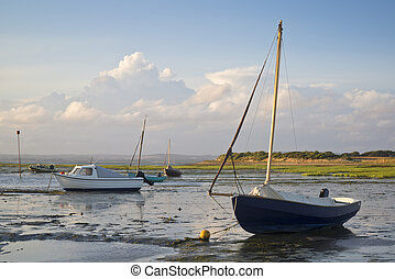 Summer evening landscape of leisure boats in harbor at low...