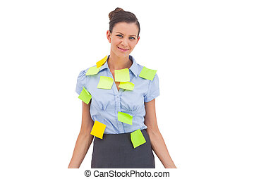 Businesswoman with sticky notes