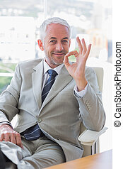 Happy businessman giving ok sign