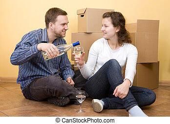 moving in - happy casual couple in new home