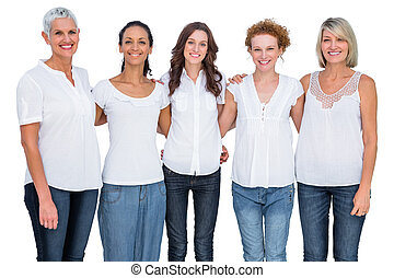 Cheerful casual models posing together on white background