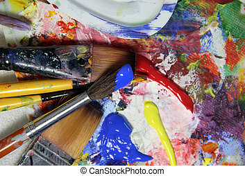 Art palette, paints and paintbrushes - Art palette with a...