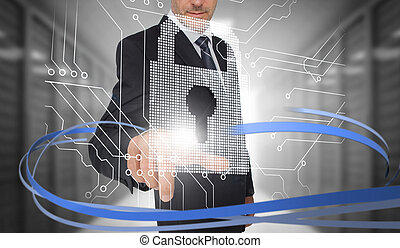 Businessman touching lock on futuristic interface with...