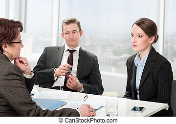 married couple consults a mature woman lawyer - couple...