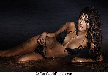 Sensual brunette woman posing on the sea. - Beautiful...