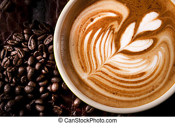 Latte Art - Latte art, coffee with roasted coffee beans...