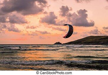 Kite Surfer - Lone kite surfer at dusk on Crantock beach in...