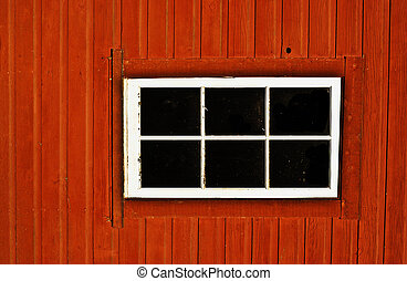 Red Barn and Window - A window on an old red barn located on...