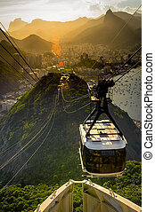 Overhead cable car approaching Sugarloaf Mountain, Rio De...
