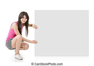 Young pretty woman holding a blank on the white background.