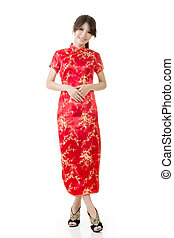 Smiling beautiful asian young woman gesturing with tradition...