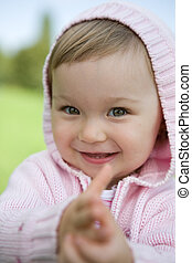 sweet baby girl - portrait of happy baby girl in park