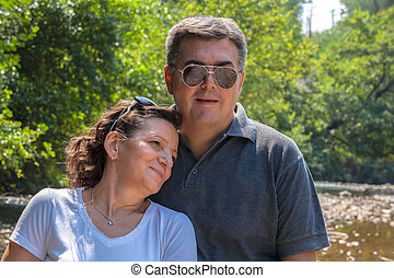 Middle-aged couple outdoors - Happy middle aged couple near...
