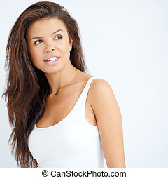 Pretty young brunette woman on white