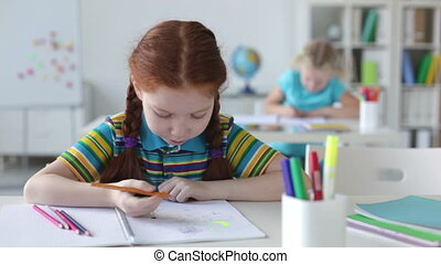 Artwork of a child - Diligent pupil in the foreground being...