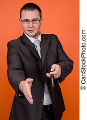 businessman with keys - real estate agent holding keys