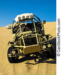 Desert buggy on the steep sand dune
