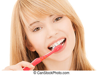 teenage girl with toothbrush - healthcare, medical and...