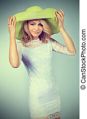 green hat - Portrait of a pretty smiling young woman in...